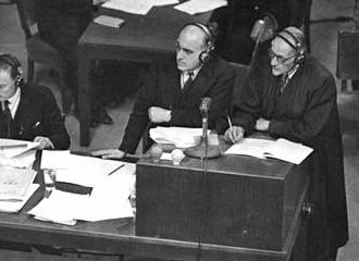 Sir David Maxell-Fyfe, centre, one of the British prosecuting team/Nuremberg