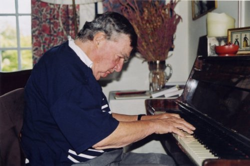 Pierre Salinger, playing piano for us, at his home in Ile le Sorgue, France 2001